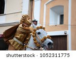 triumphing masked horseman with ... | Shutterstock . vector #1052311775