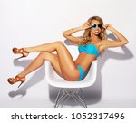 sensual blond woman with long... | Shutterstock . vector #1052317496