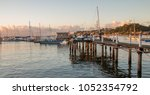 sunset with sailboats anchored... | Shutterstock . vector #1052354792