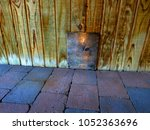 Small photo of trap door covered with wood on wooden planked wall and square brick floors