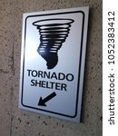 a sign points to a safe shelter ... | Shutterstock . vector #1052383412