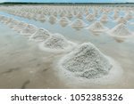piles of salt on the surface of ... | Shutterstock . vector #1052385326