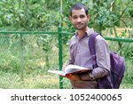 indian student in outdoor with...   Shutterstock . vector #1052400065