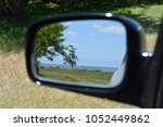 view of the lake through the... | Shutterstock . vector #1052449862