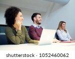 business team in meeting ... | Shutterstock . vector #1052460062