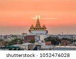 beautiful sunset behind golden...   Shutterstock . vector #1052476028