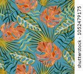 seamless tropical leaves and... | Shutterstock . vector #1052479175