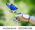 butterfly on robot hand ... | Shutterstock . vector #1052481188