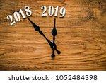 new year 2019 lie on wooden...   Shutterstock . vector #1052484398