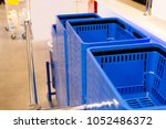Blue Shopping Cart In A Row