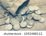 old stack of coins in sack bag... | Shutterstock . vector #1052488112