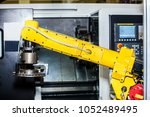 yellow robot hand in cnc... | Shutterstock . vector #1052489495