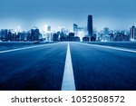 highway leading to the city ... | Shutterstock . vector #1052508572