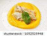 fish with pumpkin puree   Shutterstock . vector #1052525948