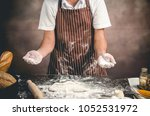 man preparing bread dough on... | Shutterstock . vector #1052531972