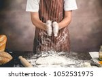 man preparing bread dough on... | Shutterstock . vector #1052531975