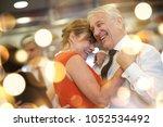 romantic senior couple dancing... | Shutterstock . vector #1052534492