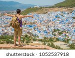 happy man tourist in the blue... | Shutterstock . vector #1052537918