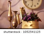 antiques. old iron  jug and... | Shutterstock . vector #1052541125
