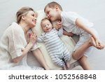 young mom with her 5 years old... | Shutterstock . vector #1052568848
