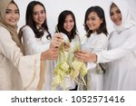 the smiling girls are holding... | Shutterstock . vector #1052571416
