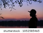 Silhouette Of A Young Woman...