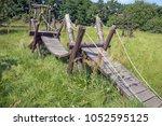 old wooden bridge on a deserted ... | Shutterstock . vector #1052595125