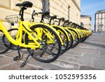 bicycles in public use in the... | Shutterstock . vector #1052595356