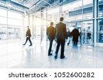 blurred crowd of people | Shutterstock . vector #1052600282