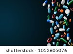 falling tablets and capsules on ...   Shutterstock . vector #1052605076