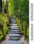 a stone path going uphill... | Shutterstock . vector #1052612318