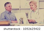 mature man comes to doctor in... | Shutterstock . vector #1052625422
