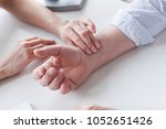 measuring of pulse on wrist by... | Shutterstock . vector #1052651426