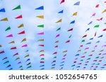 flag colorful sky carnival... | Shutterstock . vector #1052654765