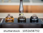 round bottles with olive oil... | Shutterstock . vector #1052658752