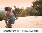 young woman in swimsuit... | Shutterstock . vector #1052660588