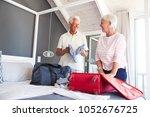 senior couple in bedroom...   Shutterstock . vector #1052676725