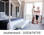 senior couple arriving at... | Shutterstock . vector #1052676755
