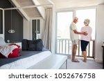 senior couple arriving at... | Shutterstock . vector #1052676758