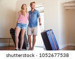 couple arriving at summer... | Shutterstock . vector #1052677538