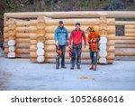 three foresters with chain saws ...   Shutterstock . vector #1052686016