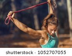 woman stretching with elastic... | Shutterstock . vector #1052707055