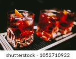 glass of iced cocktail on bar... | Shutterstock . vector #1052710922