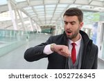 man arriving late to an... | Shutterstock . vector #1052726345