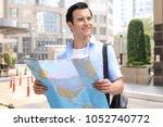 handsome  young traveller in... | Shutterstock . vector #1052740772