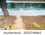 stairway to melting frozen... | Shutterstock . vector #1052746862