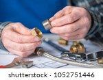 plumber hands using plumbing... | Shutterstock . vector #1052751446