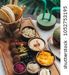 mezze platter served with pita  ... | Shutterstock . vector #1052753195