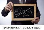80 to 20 percent written on... | Shutterstock . vector #1052754008
