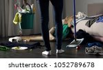 shocked cleaning lady standing... | Shutterstock . vector #1052789678